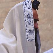 An observant Jewish man at prayer.