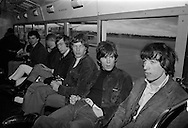 The Rolling Stones Charlie is my Darling - Ireland 1965 -..The Rolling Stones in the airport bus on route to the customs hall at Dublin Airport before thier concert at the Adelphi Theatre, Middle Abbey Street, Dublin. L-R: Brian Jones (guitar), Charlie Watts (drums), Mick Jagger (vocals), Keith Richards (guitar) and  Bill Wyman (bass). This was the band's second Irish tour of 1965....03/09/1965..09/03/1965..03 September 1965...The Rolling Stones Charlie is my Darling - Ireland 1965.Out November 2nd from ABKCO.Super Deluxe Box Set/Blu-ray and DVD Details Revealed. .ABKCO Films is proud to join in the celebration of the Rolling Stones 50th Anniversary by announcing exclusive details of the release of the legendary, but never before officially released film, The Rolling Stones Charlie is my Darling - Ireland 1965.  The film marked the cinematic debut of the band, and will be released in Super Deluxe Box Set, Blu-ray and DVD configurations on November 2nd (5th in UK & 6th in North America).. .The Rolling Stones Charlie is my Darling - Ireland 1965 was shot on a quick weekend tour of Ireland just weeks after ?(I Can't Get No) Satisfaction? hit # 1 on the charts and became the international anthem for an entire generation.  Charlie is my Darling is an intimate, behind-the-scenes diary of life on the road with the young Rolling Stones featuring the first professionally filmed concert performances of the band's long and storied touring career, documenting the early frenzy of their fans and the riots their live performances incited.. .Charlie is my Darling showcases dramatic concert footage - including electrifying performances of ?The Last Time,? ?Time Is On My Side? and the first ever concert performance of the Stones counterculture classic, ?(I Can't Get No) Satisfaction.?  Candid, off-the-cuff interviews are juxtaposed with revealing, comical scenes of the band goofing around with each other. It's also an insider's glimpse into the band's developing musical style by blen