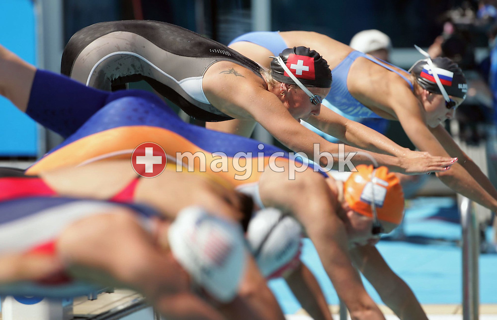 Swiss Chantal Strasser (top) starts to the women's 4x200m Freestyle Relay qualifying heat at the Athens Olympic Aquatic Centre, Wednesday 18 August 2004.     (Photo by Patrick B. Kraemer / MAGICPBK)