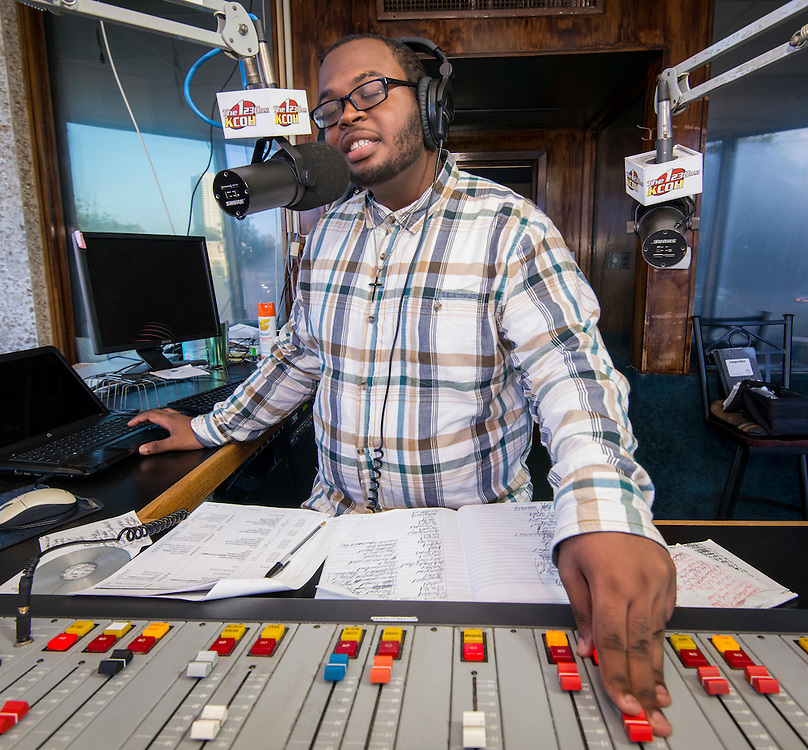 "North Forest High School senior Joseph Vaughns hosts his show ""Generation Next"" at the KCOH studio, September 20, 2014."
