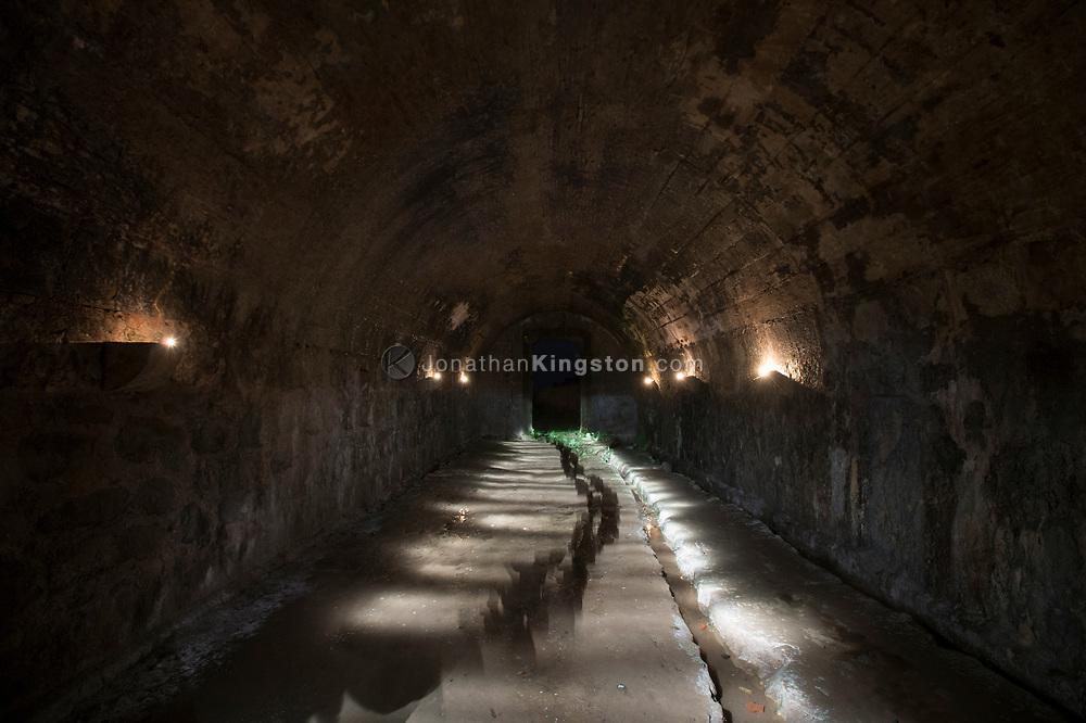The interior of Fort San Lorenzo, Panama, illuminated by candles.