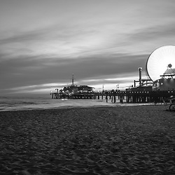 Santa Monica Pier sunset black and white photography. Santa Monica Pier is along the Pacific Ocean in Southern California in the United States. Copyright ⓒ 2017 Paul Velgos with All Rights Reserved.
