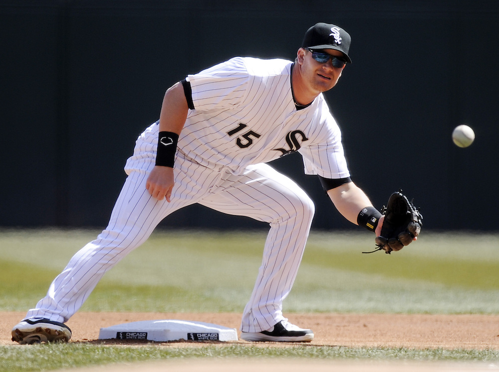 CHICAGO - APRIL 03:  Gordon Beckham #15 of the Chicago White Sox fields against the Kansas City Royals on April 3, 2013 at U.S. Cellular Field in Chicago, Illinois.  The White Sox defeated the Royals 5-2.  (Photo by Ron Vesely)   Subject: Gordon Beckham