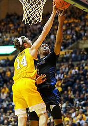Nov 9, 2018; Morgantown, WV, USA; West Virginia Mountaineers guard Chase Harler (14) blocks a shot from Buffalo Bulls guard Davonta Jordan (4) during the first half at WVU Coliseum. Mandatory Credit: Ben Queen-USA TODAY Sports