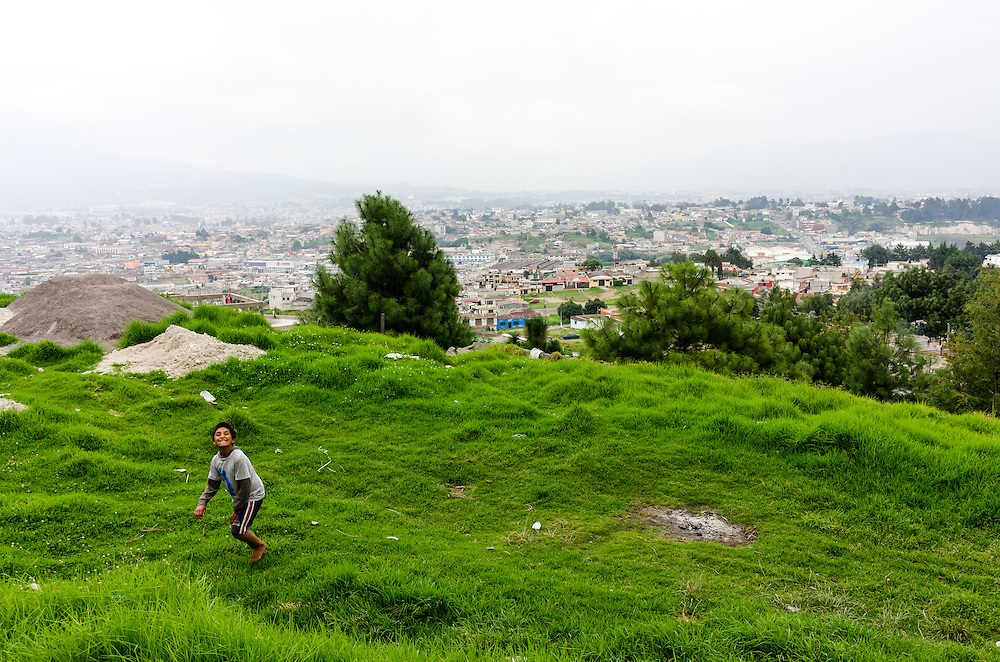 A boy plays on the base of El Baúl.