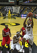 January 04 2010: Iowa Hawkeyes forward Jarryd Cole (50) puts up a shot as Ohio State Buckeyes forward Dallas Lauderdale (52) and Iowa Hawkeyes forward Melsahn Basabe (1) look on during the second half of an NCAA college basketball game at Carver-Hawkeye Arena in Iowa City, Iowa on January 04, 2010. Ohio State defeated Iowa 73-68.