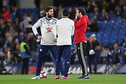 Chelsea's Cesc Fabregas chats to Juan Mata Midfielder of Manchester United in warm up during the The FA Cup quarter-final match between Chelsea and Manchester United at Stamford Bridge, London, England on 13 March 2017. Photo by Phil Duncan.