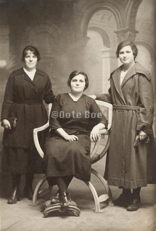 vintage photo of 3 girls posing in studio