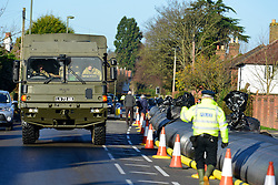 © Licensed to London News Pictures. 16/02/2014. Chertsey, UK. Troops arrive to check the dam and talk with residents over concerns.  An Aqua dam has been erected along Bridge Road in Chertsey, Surrey. At almost half a mile long and four feet high the dam is designed to protect 200 houses on the South Side of the street. The Environment Agency has said there is nothing they can do to protect the houses on the North side if flood water from the River Thames rises. . Photo credit : Stephen Simpson/LNP