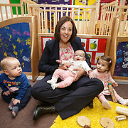 Scottish Labour leader visits nursery. Kezia Dugdale during a visit to Castlemilk Stables nursery in Glasgow to mark the deadline John Swinney set for Scottish councils to meet new funding deal. With children Blake McMillan(L), holding Bethany McLaren (C) and Marabelle O'Hanlon (R). Picture Robert Perry 9th Jan 2016<br /> <br /> Must credit photo to Robert Perry<br /> FEE PAYABLE FOR REPRO USE<br /> FEE PAYABLE FOR ALL INTERNET USE<br /> www.robertperry.co.uk<br /> NB -This image is not to be distributed without the prior consent of the copyright holder.<br /> in using this image you agree to abide by terms and conditions as stated in this caption.<br /> All monies payable to Robert Perry<br /> <br /> (PLEASE DO NOT REMOVE THIS CAPTION)<br /> This image is intended for Editorial use (e.g. news). Any commercial or promotional use requires additional clearance. <br /> Copyright 2014 All rights protected.<br /> first use only<br /> contact details<br /> Robert Perry     <br /> 07702 631 477<br /> robertperryphotos@gmail.com<br /> no internet usage without prior consent.         <br /> Robert Perry reserves the right to pursue unauthorised use of this image . If you violate my intellectual property you may be liable for  damages, loss of income, and profits you derive from the use of this image.