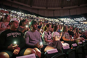 Students participate in a game using phone flash lights during the 2019 First Year Convocation. Photo by Hannah Ruhoff