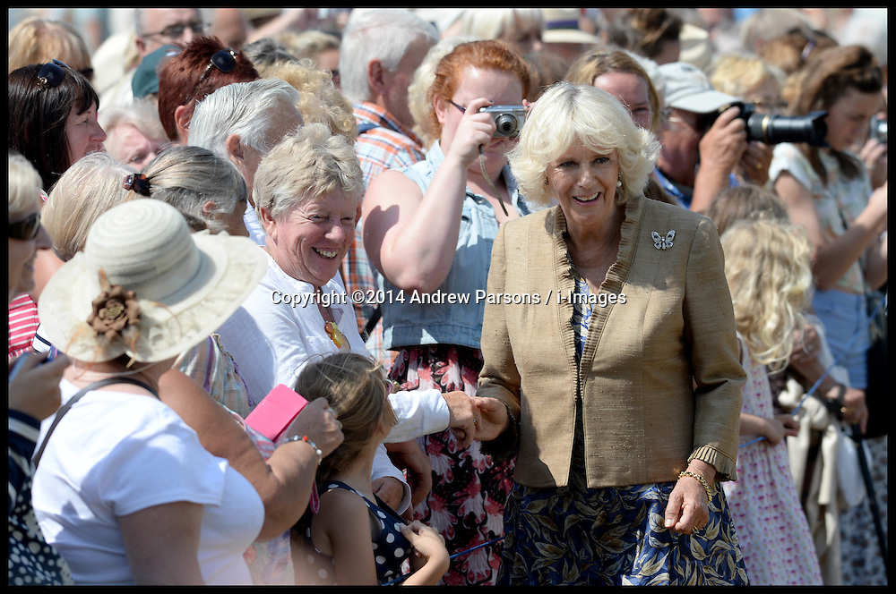 Image ©Licensed to i-Images Picture Agency. 30/07/2014. Norfolk, United Kingdom. Prince Charles and The Duchess of Cornwall visit the Sandringham Flower show on the Queen's Sandringham estate, Norfolk. Picture by Andrew Parsons / i-Images