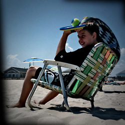 My son Cole relaxes on the beach in NJ.