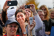A woman in the crowd is moved during a campaign speach by U.S. President Barack Obama in Nashua, New Hampshire, just a few days before his 2012 reelection.