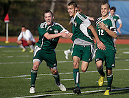 Middletown, New York - Chazy's Josh Barriere, center, celebrates with teammates Nelson Pelton, left, and Nathan Reynolds after scoring one of his three goals in the Class D state championship boys' soccer game against Fort Ann at Faller Field in Middletown on Nov. 18, 2012. Chazy won 4-0 for its sixth state championship in boys' soccer.