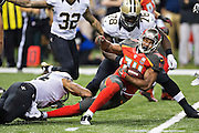 NEW ORLEANS, LA - SEPTEMBER 20:  Charles Sims #34 of the Tampa Bay Buccaneers runs the ball during a game against the New Orleans Saints at Mercedes-Benz Superdome on September 20, 2015 in New Orleans Louisiana.  The Buccaneers defeated the Saints 26-19. (Photo by Wesley Hitt/Getty Images) *** Local Caption *** Charles Sims