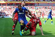 Walsall FC defender Jason McCarthy (5) tackles AFC Wimbledon defender & captain Barry Fuller (2) during the EFL Sky Bet League 1 match between Walsall and AFC Wimbledon at the Banks's Stadium, Walsall, England on 6 August 2016. Photo by Stuart Butcher.