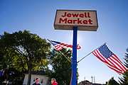 "03 AUGUST 2020 - JEWELL, IOWA:  The only grocery store in Jewell, a small community in central Iowa, closed in 2019. It served four communities within a 20 mile radius of Jewell. Some of the town's residents created a cooperative to reopen the store. They sold shares to the co-op and  held fundraisers through the spring. Organizers raised about $225,000 and bought the store, which had its ""soft opening"" July 8. The store celebrated its official reopening Monday August 3. Before the reopening, Jewell had been a ""food desert"" for seven months. The USDA defines rural food deserts as having at least 500 people in a census tract living 10 miles from a large grocery store or supermarket. There is a convenience store in Jewell, but it sells mostly heavily processed, unhealthy snack foods that are high in fat, sugar, and salt.            PHOTO BY JACK KURTZ"