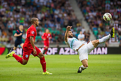 Bojan Jokic of Slovenia and Jordan Henderson of England during the EURO 2016 Qualifier Group E match between Slovenia and England at SRC Stozice on June 14, 2015 in Ljubljana, Slovenia. Photo by Grega Valancic