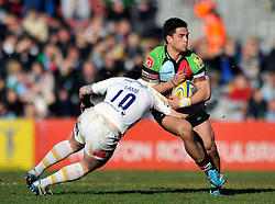 Ben Botica (Harlequins) is tackled by Ryan Lamb (Worcester) - Photo mandatory by-line: Patrick Khachfe/JMP - Tel: Mobile: 07966 386802 01/03/2014 - SPORT - RUGBY UNION - The Twickenham Stoop, London - Harlequins v Worcester Warriors - Aviva Premiership.