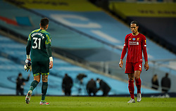 MANCHESTER, ENGLAND - Thursday, July 2, 2020: Liverpool's Virgil van Dijk looks dejected as he  walks towards Manchester City's goalkeeper Ederson Santana de Moraes after the FA Premier League match between Manchester City FC and Liverpool FC at the City of Manchester Stadium. The game was played behind closed doors due to the UK government's social distancing laws during the Coronavirus COVID-19 Pandemic. This was Liverpool's first game as Premier League 2019/20 Champions. Manchester City won 4-0. (Pic by Propaganda)