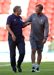 Blackburn Rovers manager Tony Mowbray (left) and Liverpool manager Jurgen Klopp in discussion prior to kick-off