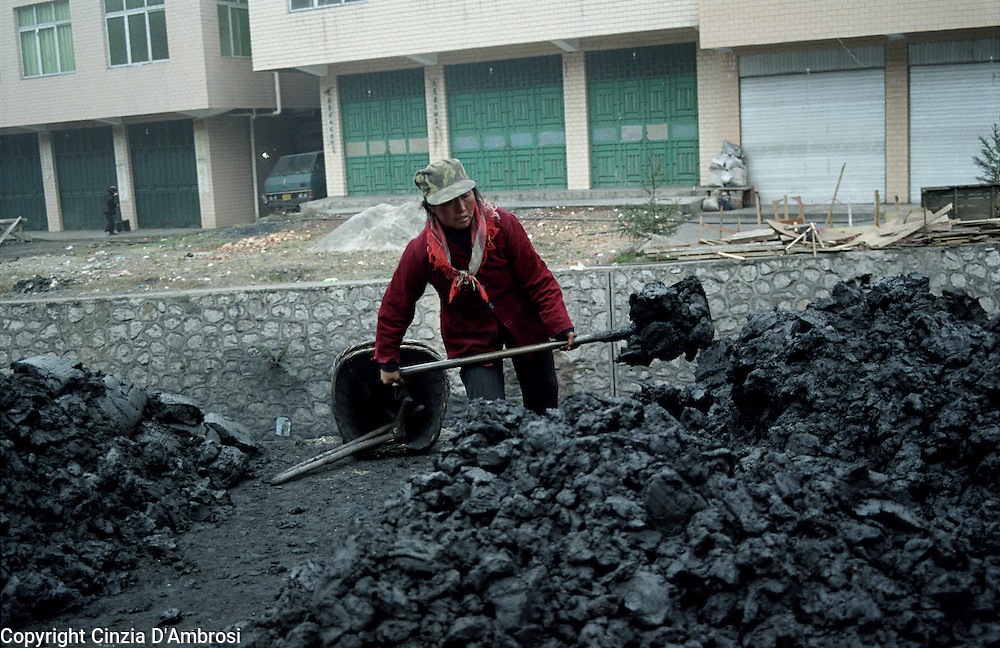 There are a lot of women working in coal mining overground in China. They are not allowed underground due to superstitious belief that they would bring bad luck. Their tasks are equal to men.  Overground they dug coal and carry to refineries. Wangjizhai, South West  China.