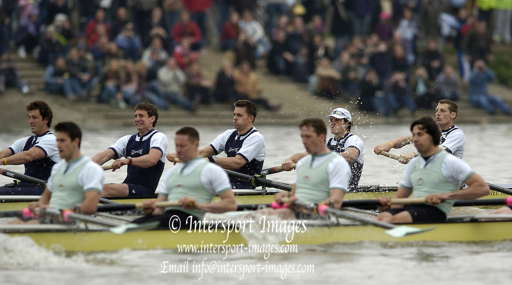 2005 Varsity Boat Race, Greater London, ENGLAND, Boat Race between Oxford [Dark Blue] and Cambridge[ Light Blue] over the Championship Course between Putney and Mortlake..Both Crews racing along the Putney hard...CUBC Crew [Light Blue] - Bow. Luke Walton, 2. Tom Edwards, 3. Henry Adams, 4 Steffen Buschbacher, 5. Sebastian Schlute, 6. Matthias Kleinz, 7. Tom James, Stroke, Bernd Heidicker, and cox. Peter Rudge...OUBC Crew [Dark Blue] - Bow. Robin Bourne-Taylor, 2. Barney Williams, 3. Peter Reed, 4. Joe Von Maltzahn, 5. Chris Liwski, 6. Mike Blomquist, 7. Jason Flickinger, Stroke, Andy Twiggs-Hodge, cox Acer Nethercott. ..Photo  Peter Spurrier. .email images@intersport-images....[Mandatory Credit Peter Spurrier/ Intersport Images] Varsity:Boat Race