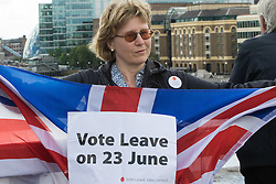 London Bridge, London, June 15th 2016. A flotilla of fishing boats led by UKIP's Nigel Farage heads through Tower Bridge in protest against the EU's Common Fisheries Policy and in support of Britain leaving the EU. PICTURED: A woman on London Bridge shows her support for the Leave campaign.