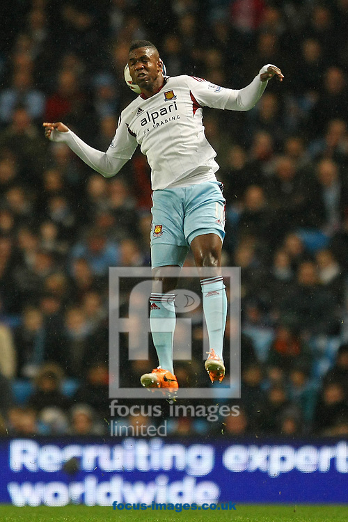 Picture by Paul Chesterton/Focus Images Ltd +44 7904 640267<br /> 08/01/2014<br /> Modibo Maiga of West Ham in action during the Capital One Cup Semi Final 1st Leg match at the Etihad Stadium, Manchester.