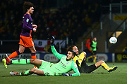 Burton Albion midfielder Marcus Harness (16) clashes with Manchester City's goalkeeper Aro Muric (49) during the EFL Cup semi final second leg match between Burton Albion and Manchester City at the Pirelli Stadium, Burton upon Trent, England on 23 January 2019.