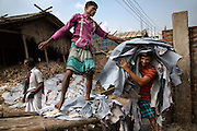 """Slaves of Hazaribagh<br /> <br /> Hazaribagh is an area of Dhaka city, the capital of Bangladesh, and is known for its tannery industry and large leather processing zone. Up to 95% of the registered tanneries in Bangladesh are located in and around Hazaribagh. Currently, more than 2000 tanneries operate here, employing between 8.000 and 15.000 people. <br /> In 2013, the Zurich-based Green Cross Switzerland and the New York-based Blacksmith Institute published a report on the most polluted places in the world. The report """"The Top Ten Toxic Threats, Clean Up, Progress and Ongoing Challenges"""", puts Hazaribagh at number five. Most of the 185.000 people living in this area work in the factories and tanneries. They are forced to live in highly polluted environments.  A lot of children and teenagers also work in the factories.<br /> <br /> Photo Shows: Here people toil 12 to 14 hours a day, seven days a week. They usually earn less than $2 a day, according to the local Tannery Workers Union.<br /> ©Pascal Mannaerts/Exclusivepix Media"""