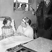 One of most popular visitors to Ireland was Her Serene Highness, Princess Grace of Monaco, formerly Grace Kelly. Here she chats with a  young patient in Our Lady's Hospital, Crumlin..12.06.1961
