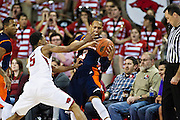 FAYETTEVILLE, AR - DECEMBER 19:  Terence Smith #3 of the UT Martin Skyhawks is being defended by Anthlon Bell #5 of the Arkansas Razorbacks at Bud Walton Arena on December 19, 2013 in Fayetteville, Arkansas.  The Razorbacks defeated the Skyhawks 102-56.  (Photo by Wesley Hitt/Getty Images) *** Local Caption *** Terence Smith; Anthlon Bell
