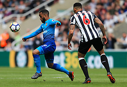 Alexandre Lacazette of Arsenal and Jamaal Lascelles of Newcastle United - Mandatory by-line: Matt McNulty/JMP - 15/04/2018 - FOOTBALL - St James Park - Newcastle upon Tyne, England - Newcastle United v Arsenal - Premier League
