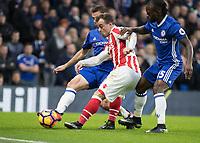 Football - 2016 / 2017 Premier League - Chelsea vs. Stoke City <br /> <br />  Cesar Azpilicueta of Chelsea gets a foot in to block Xherdan Shaqiri of Stoke City at Stamford Bridge.<br /> <br /> COLORSPORT/DANIEL BEARHAM