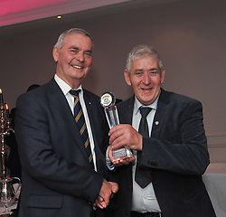 Johnny Nolan is pictured accecpting Club and Community service award from guest speaker Brian McEniff at the Kilmeena Gaa celebration night recently. <br />Pic Conor McKeown