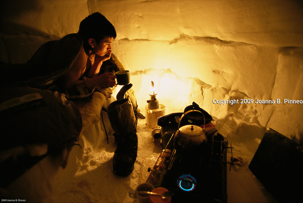 On a polar bear hunt in Nunavut, Canada. The young hunter sleeps in an Igloo while on the native hunt.