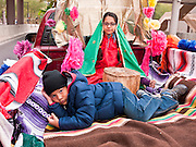 "03 DECEMBER 2011 - PHOENIX, AZ:    A boys lays in the bed of a pickup truck while his sister portrays the Virgin of Guadalupe in a procession in Phoenix Saturday. The Phoenix diocese of the Roman Catholic Church held its Sixth Annual Honor Your Mother Day Saturday to honor the Virgin of Guadalupe. According to Mexican Catholic tradition, on December 9, 1531 Juan Diego, an indigenous peasant, had a vision of a young woman while he was on a hill in the Tepeyac desert, near Mexico City. The woman told him to build a church exactly on the spot where they were standing. He told the local bishop, who asked for some proof. He went back and had the vision again. He told the lady that the bishop wanted proof, and she said ""Bring the roses behind you."" Turning to look, he found a rose bush growing behind him. He cut the roses, placed them in his poncho and returned to the bishop, saying he had brought proof. When he opened his poncho, instead of roses, there was an image of the young lady in the vision. The Virgin is now honored on Dec 12 in Catholic churches throughout Latin America and in Hispanic communitied in the US.   PHOTO BY JACK KURTZ"
