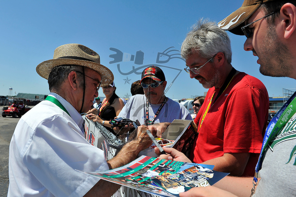 Brooklyn, MI - JUN 15, 2012: Jack Roush signs autographs in the garage during practice for the Quicken Loans 400 race at the Michigan International Speedway in Brooklyn, MI.