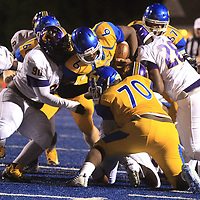 Tupelo quarterback Stephon McGlaun fights his way through the Columbus defense in the first quarter.