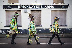 January 14, 2017 - Whittlesey, Cambridgshire, UK - Whittlesey UK. Picture shows members of the Bourne Borderers Molly dancers at the 38th Whittlesey Straw Bear Festival this weekend. In times past when starvation bit deep the ploughmen of the area where drawn to towns like Whittlesey, They knocked on doors begging for food & disguised their shame by blackening their faces with soot. In Whittlesey it was the custom on the Tuesday following Plough Monday to dress one of the confraternity of the plough in straw and call him a Straw Bear. The bear was then taken around town to entertain the folk who on the previous day had subscribed to the rustics, a spread of beer, tobacco & beef. The bear was made to dance in front of houses & gifts of money, beer & food was expected. (Credit Image: © Andrew Mccaren/London News Pictures via ZUMA Wire)
