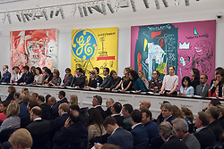"© Licensed to London News Pictures. 28/06/2017. London, UK. Sotheby's staff bid on behalf of telephone clients in front of (L to R) ""The Girl Who Had Everything"", 1998, by Cecily Brown sold for a hammer price of GBP1.55m (estimate GBP0.8-1.2m), ""Sweet Pungent"", 1984-85, a collaborative work by Andy Warhol and Jean-Michael Basquiat sold for a hammer price of GBP3.8 m (estimate GBP1.4-1.8m) and ""New Flame"", 1985, a collaborative work by Andy Warhol and Jean-Michael Basquiat sold for a hammer price of GBP2m (estimate GBP1.7-2.2m) at Sotheby's Contemporary Art evening sale in New Bond Street, which featured pioneering works from the Pop Art genre. Photo credit : Stephen Chung/LNP"