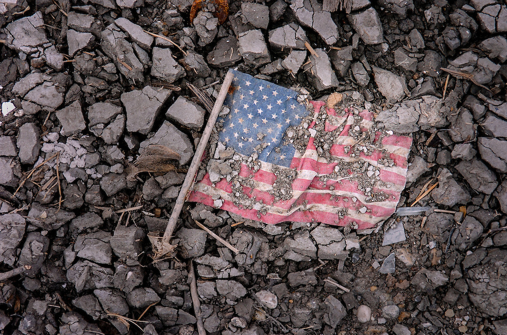 This American Flag dries in the mud on a street in the Ninth Ward area of New Orleans which was destroyed by Hurricane Katrina and the subsequent levee failures.<br /> www.kathyandersonphotography.com