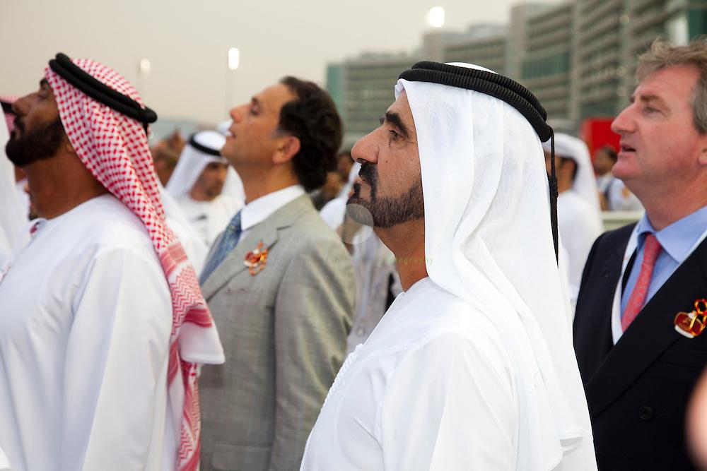 His Highness Sheikh Mohammed bin Rashid Al Maktoum (center) watches a race at the Dubai World Cup 2010, taking place at the new Meydan racecourse in Dubai.