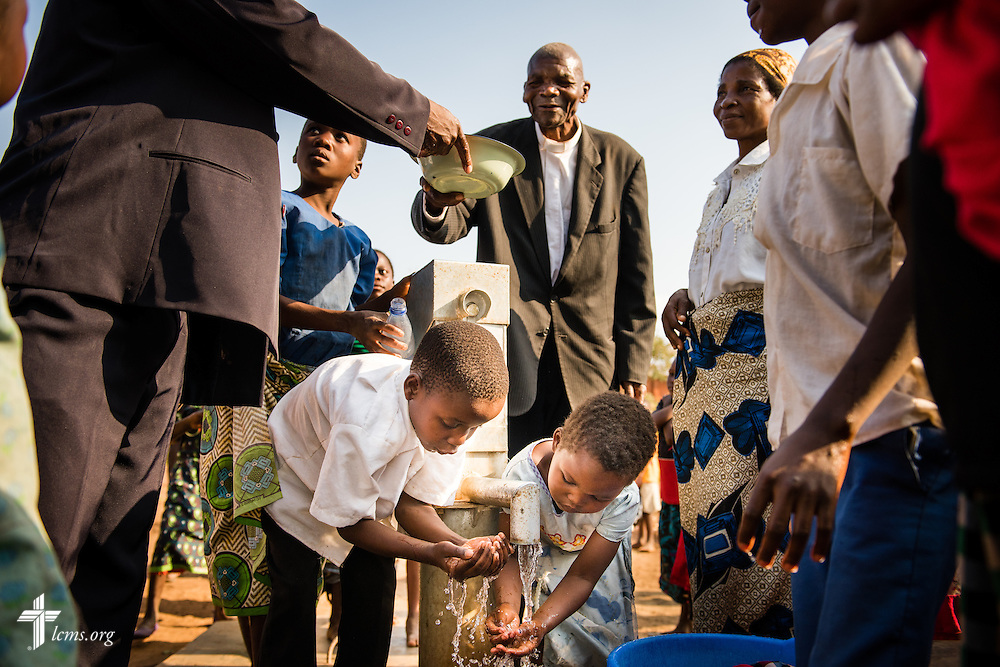 Church and community members gather for clean water at an LCMS funded borehole well near the Confessional Lutheran Church–Malawi Synod parish on Sunday, Sept. 27, 2015, in Chingale, Malawi. LCMS Communications/Erik M. Lunsford