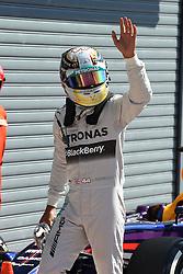 06.09.2014, Autodromo di Monza, Monza, ITA, FIA, Formel 1, Grand Prix von Italien, Qualifying, im Bild 06.09.2014, Autodromo di Monza, Monza, ITA, FIA, Formel 1, Grand Prix von Italien, Qualifying, im Bild Pole sitter Lewis Hamilton (GBR) Mercedes AMG F1 celebrates in parc ferme // during the Qualifying of Italian Formula One Grand Prix at the Autodromo di Monza in Monza, Italy on 2014/09/06. EXPA Pictures © 2014, PhotoCredit: EXPA/ Sutton Images<br /> <br /> *****ATTENTION - for AUT, SLO, CRO, SRB, BIH, MAZ only*****