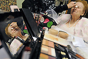 ANDREW JANSEN / JOURNAL.Mary Kay makeup artist Barbara Heitert applies lipstick to Angie Longo before the Valentine's fashion show at Southgate Bethesda.