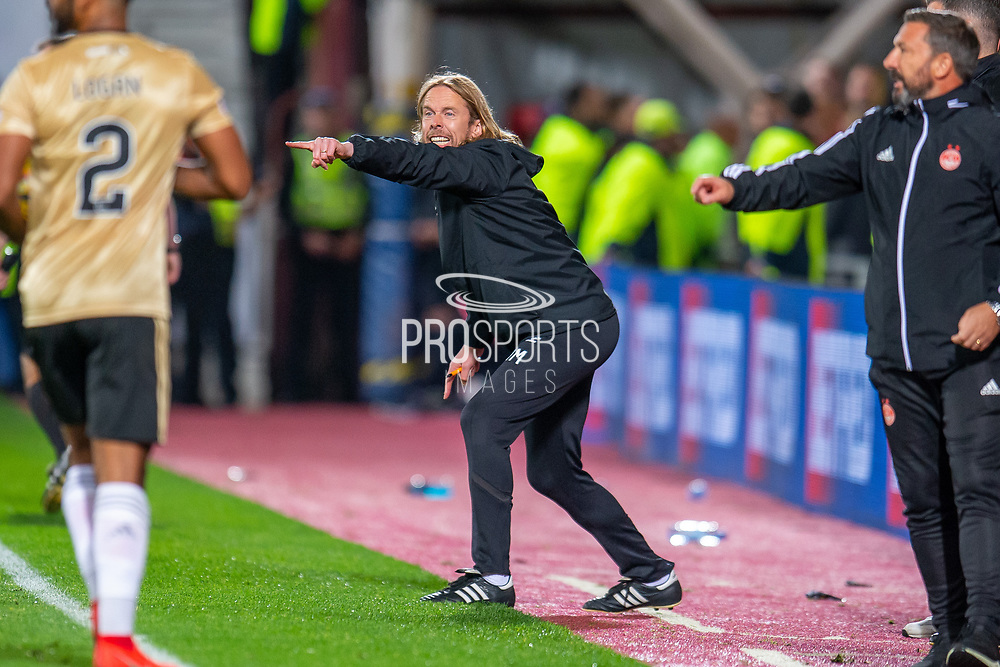 Heart of Midlothian assistant manager Austin MacPhee shouts encouragement from the technical area during the Betfred Scottish Football League Cup quarter final match between Heart of Midlothian FC and Aberdeen FC at Tynecastle Stadium, Edinburgh, Scotland on 25 September 2019.