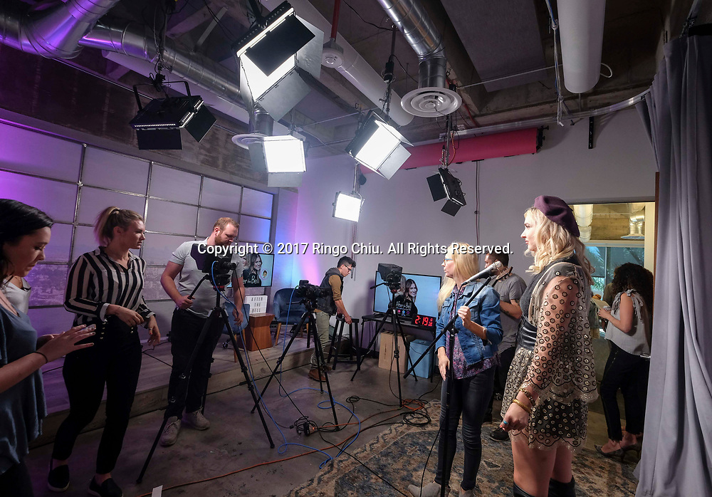 Singer Maty Noyes, right, in the studio of Sweety High, a company that markets to Generation Z girls (8-18). (Photo by Ringo Chiu)<br /> <br /> Usage Notes: This content is intended for editorial use only. For other uses, additional clearances may be required.